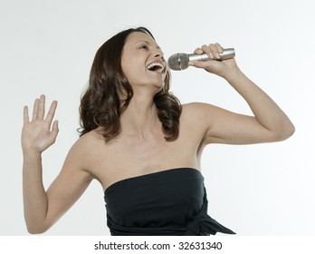 portrait of a beautiful asian woman on isolated white background singing