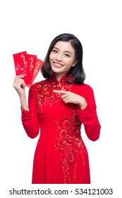 Portrait of a beautiful Asian woman on traditional festival costume Ao Dai holding red pocket - lucky money. Tet holiday. Lunar New Year. Text mean Happy New Year.