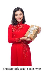 Portrait of a beautiful Asian woman on traditional festival costume Ao Dai holding Gift Box. Tet holiday. Lunar New Year.