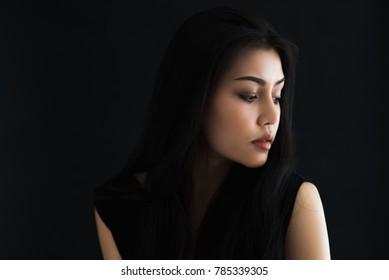 Portrait of beautiful asian woman on black background