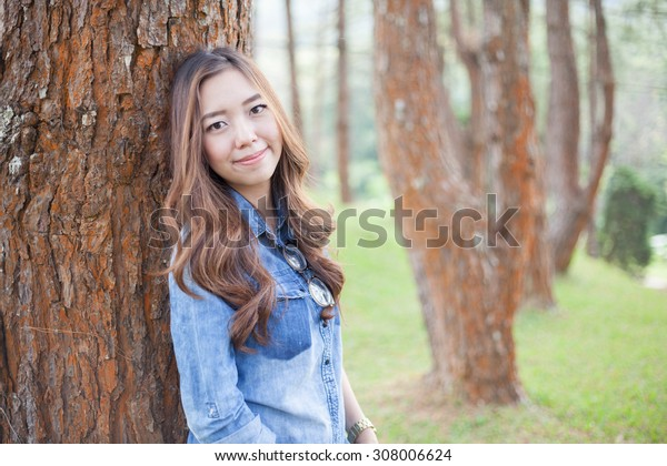A portrait of beautiful asian woman on the park