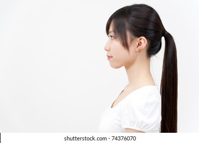 a portrait of beautiful asian woman with ponytail hair