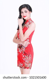 Portrait of beautiful asian woman in red chinese dress traditional cheongsam. chinese new year concept. Cheerful girl in red cheongsam on white background.