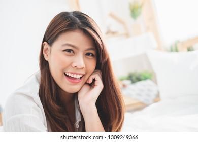 Portrait beautiful Asian woman showing perfect white teeth
