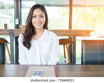 Portrait of Beautiful Asian woman smiling at the coffee cafe - Small business owner female smart lifestyle.