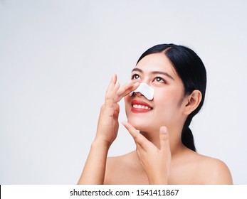 Portrait Beautiful Asian woman standing over white background,copy space,cosmetic skin care concept.