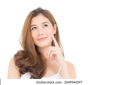 Portrait of beautiful asian woman thinking something and makeup of cosmetic - girl hand touch cheek and smile on attractive face with skin healthcare concept isolated on white background.