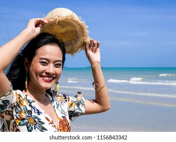2f3de7d904 Portrait of beautiful Asian woman wearing bohemian clothing style with a  hat and earrings smiling face