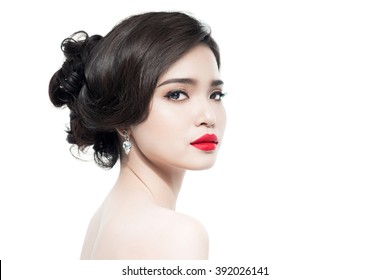 Portrait of Beautiful Asian Woman Wedding Model Isolated on White Background. Advertising and Commercial Design. Shopping. Jewelry - Bridal Earrings, Hairstyle