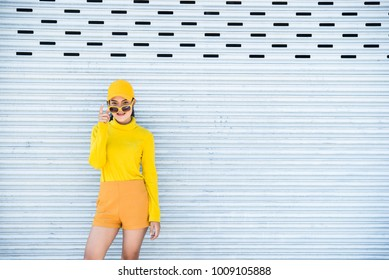 Portrait of beautiful asian woman in yellow cloths,Hipsters girl wear yellow hat  take a picture,Thailand people