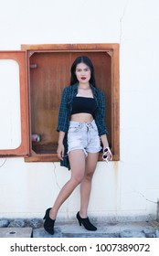 Portrait of beautiful asian woman,Hipsters girl for take a picture outdoor,Thailand people
