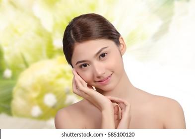 Portrait of Beautiful Asian women on Flower background