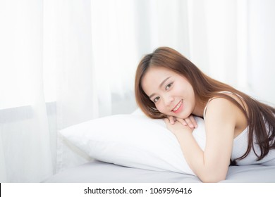 Portrait of beautiful asian young woman sleep lying in bed with head on pillow comfortable and happy with leisure, girl with relax  for health and lifestyle concept.
