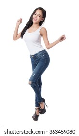 Portrait of a beautiful asian young woman in a blue jeans and white shirt, isolated on white background