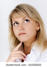 Portrait of a beautiful attractive blonde in a white blouse