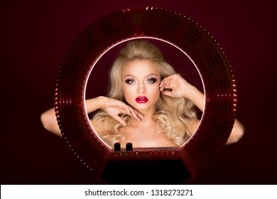 Portrait beautiful attractive blonde woman looking in round light. Beautyful girl with bright make up and beautiful hairstyle. Red lips