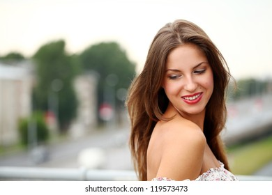 Portrait of beautiful and attractive brunette over summer background