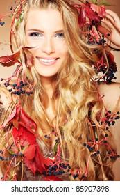 Portrait of a beautiful autumn woman.
