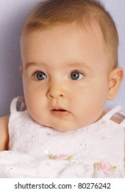 Portrait of a beautiful baby with big blue eyes