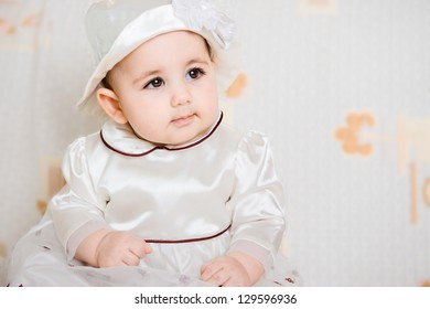 Portrait of beautiful  baby girl in dress and hat
