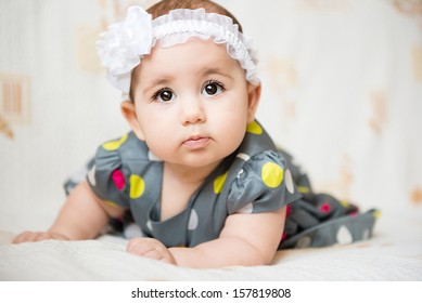 Portrait of beautiful  baby girl on white background