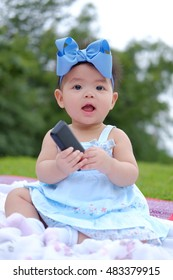 Portrait of a beautiful baby girl,Cute baby 7 months, close-up portrait,Beautiful baby girl in park,Little asian girl was playing happily and smiling in the park