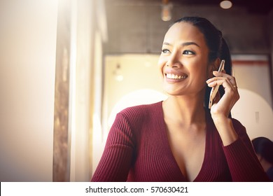 Portrait of beautiful black hair Business woman smile and using her smartphone after work.Successful celebrate party confirm concept.