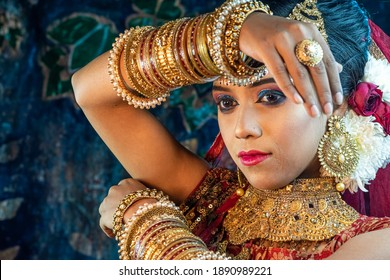 Portrait of beautiful black haired Indian brunette  woman wearing jewellery with traditional dress