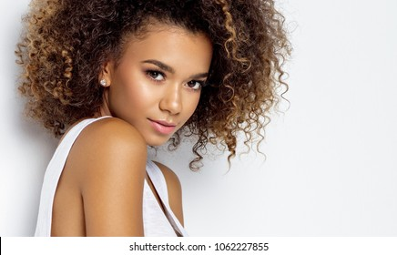 Portrait of beautiful black woman isolated  - Shutterstock ID 1062227855