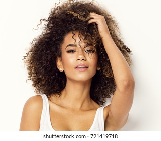 Portrait of beautiful black woman isolated on white