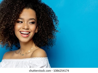 Portrait Of Beautiful Black Woman With Smiling Face Isolated On Blue Background
