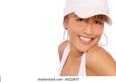 portrait of beautiful blond girl in baseball cap posing on white
