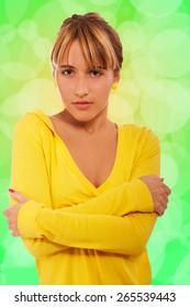 portrait of beautiful blond girl posing on green