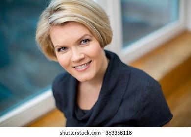 Portrait of a beautiful blond woman in an elegant dress