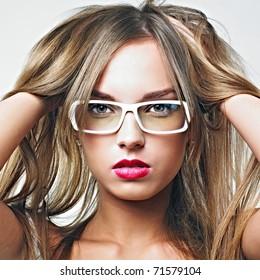 portrait of beautiful blond woman in glasses