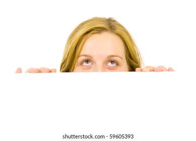 Portrait of a beautiful blond woman holding a blank billboard
