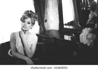 Portrait of Beautiful Blond Woman with Long Hair and Clean Skin. Brigitte Bardot look. Perfect Make-Up and Coiffure