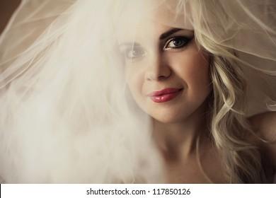 portrait of a beautiful blonde bride. daylight. studio shot