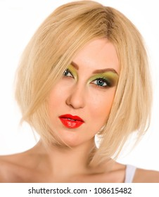 portrait of a beautiful blonde girl with short hair and bright colored makeup, photographed in the studio against a plain white background