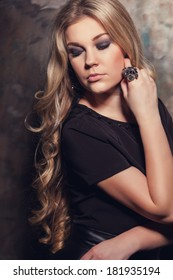 portrait of a beautiful blonde girl in the studio with magnificent hair