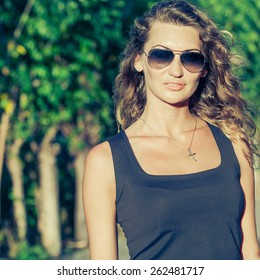 portrait of a beautiful blonde girl with sunglasses at the day time
