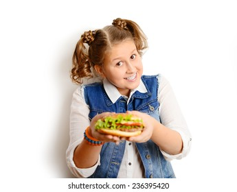 portrait of a beautiful blonde girl, teenager and schoolgirl, holding a hamburger on a white background
