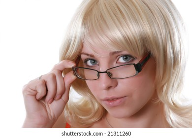 Portrait of the beautiful blonde in glasses on a white background