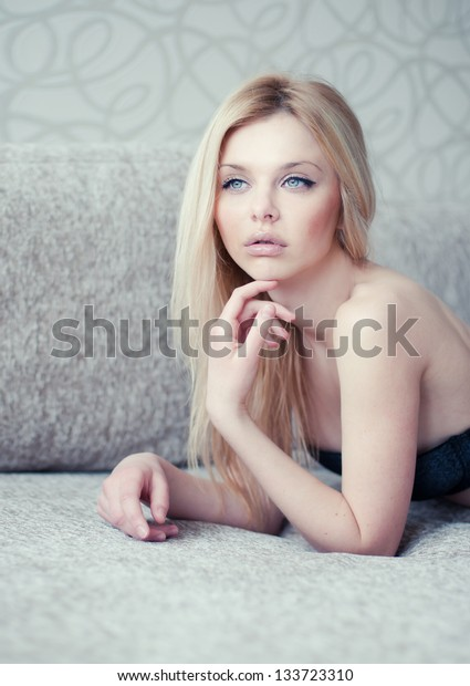 portrait of a beautiful blonde at home