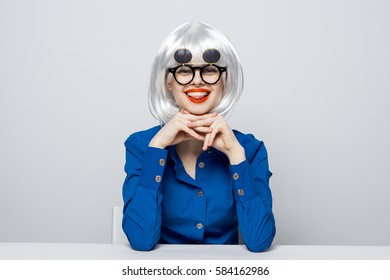 portrait beautiful blonde on light background red lips with glasses smiling