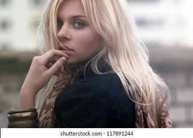 portrait of a beautiful blonde outdoor on the street