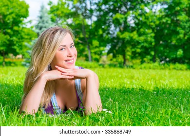 portrait of a beautiful blonde resting on the meadow
