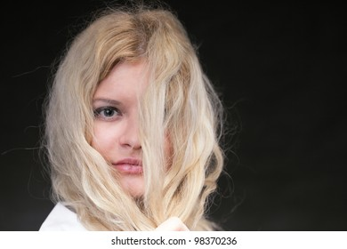 portrait of beautiful blonde woman black background