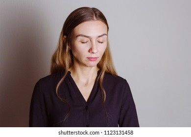 Portrait of a beautiful blonde woman with closed eyes