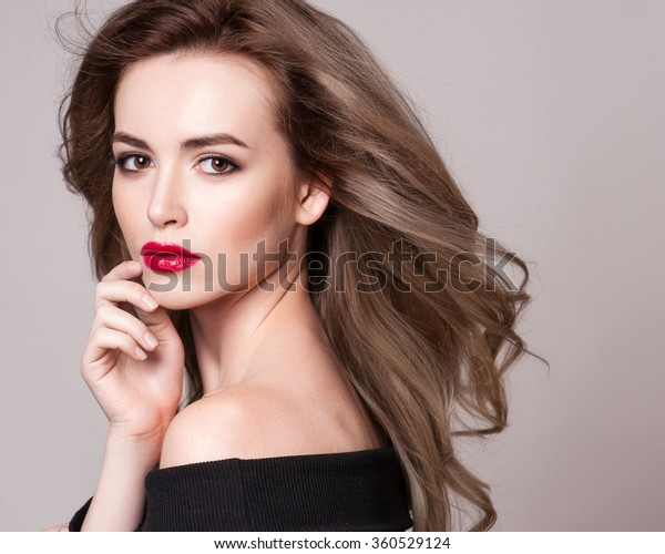 Portrait of beautiful blonde woman with curly hairstyle and bright makeup, perfect skin, skincare, spa, cosmetology. Sexy vogue woman face, sensual beauty girl model. Natural look. studio, isolated.